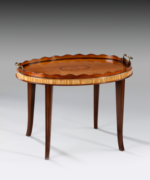 A Sheraton oval tray in satinwood