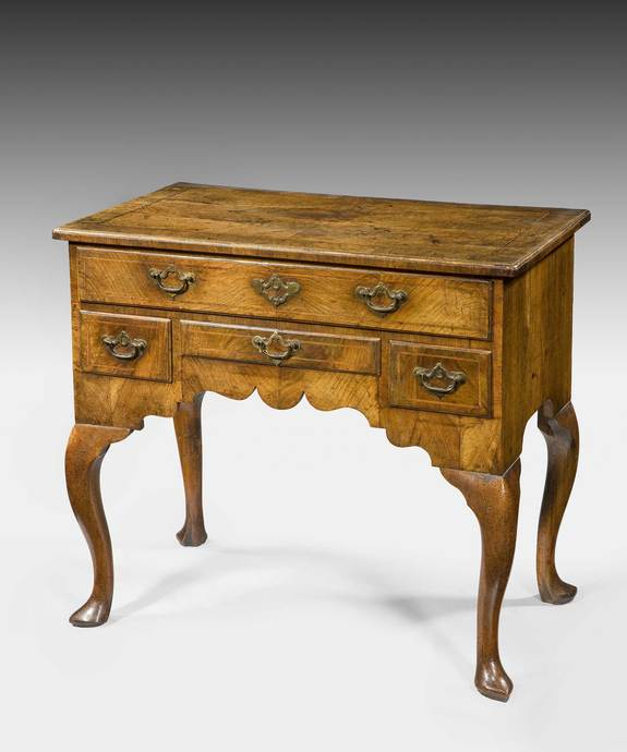 A beautifully patinated Queen Anne period walnut veneered lowboy. Large Image 1