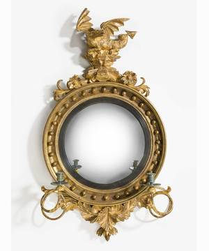 A fine Regency period carved giltwood convex mirror.