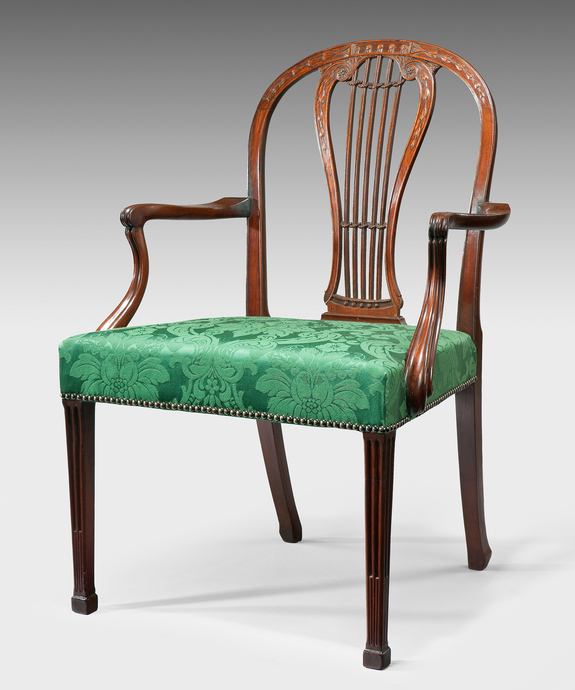 An antique George III Adam period mahogany armchair.