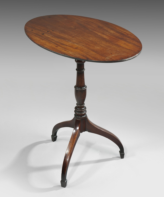 A Sheraton mahogany tripod table.