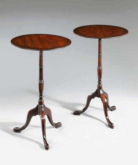 Antique pair of Sheraton mahogany tripod tables.