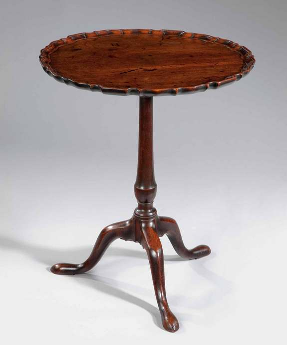 A well patinated Chippendale period piecrust tripod table. Large Image 1
