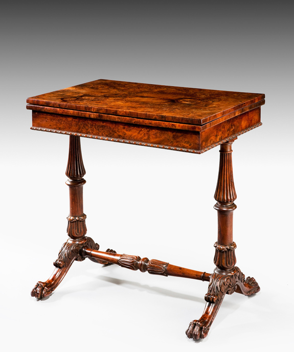 A 19th Century yew games table.
