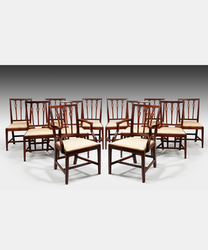 A well patinated set of twelve (10+2) Sheraton period mahogany dining chairs.