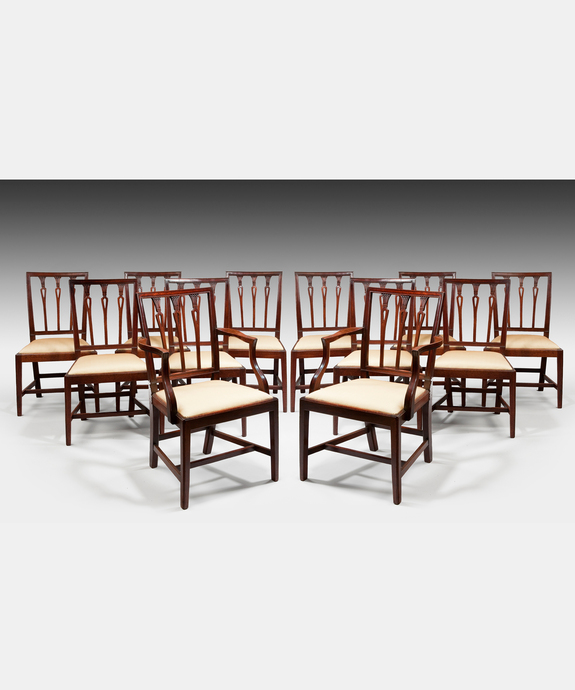 A well patinated set of twelve (10+2) Sheraton period mahogany dining chairs. Large Image 1
