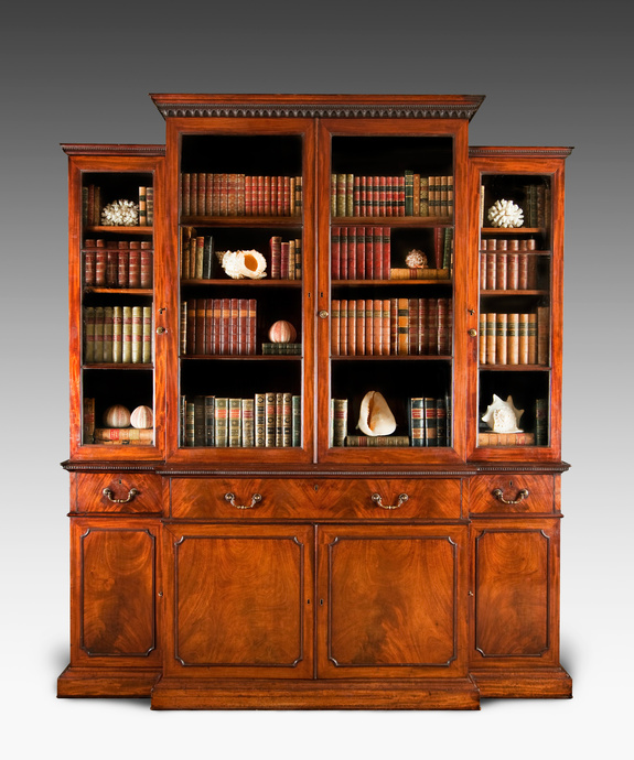 A handsome Chippendale period mahogany breakfront bookcase. Large Image 1