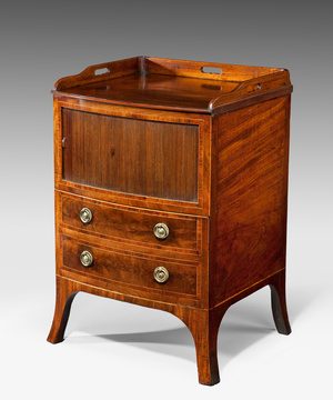An elegant Sheraton period bowfronted commode.