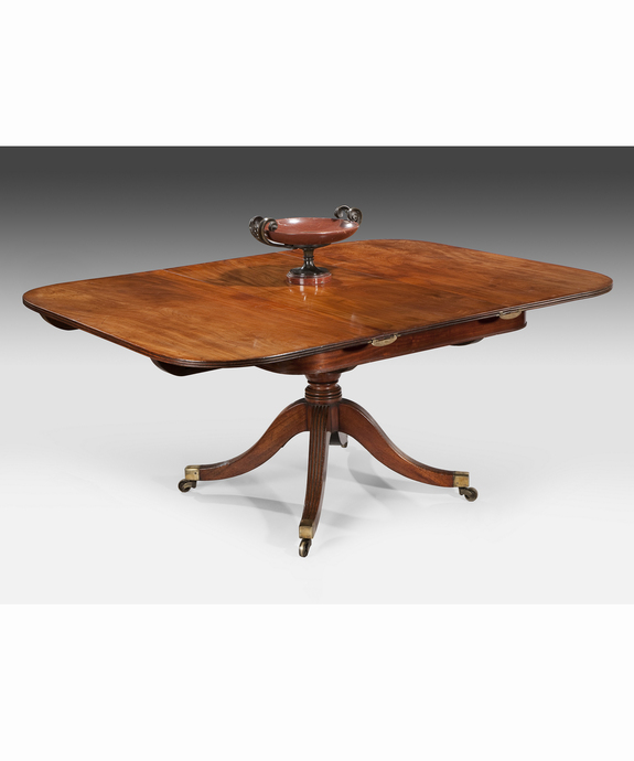 A Regency period mahogany extending table. Large Image 1