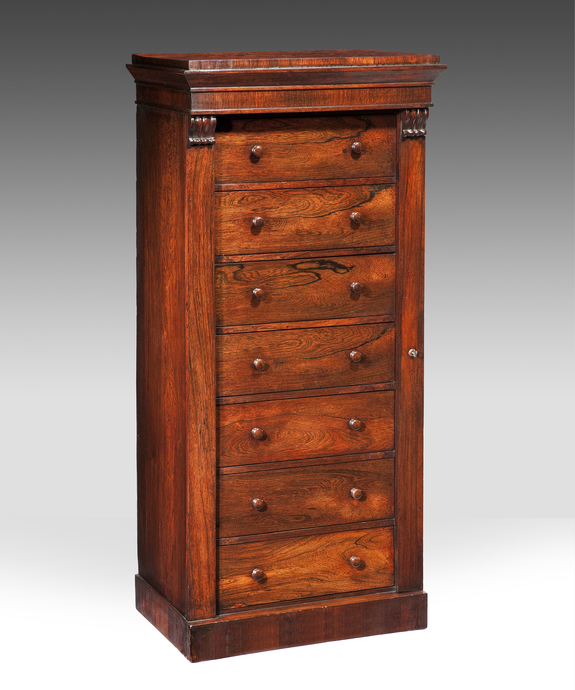 A good Regency period rosewood veneered wellington chest.