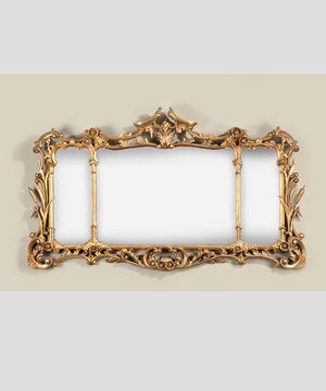 A Chippendale style overmantel mirror.