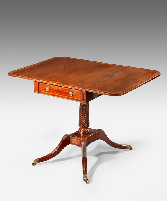 An antique Georgian pembroke table.