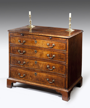 A superb George I period veneered walnut chest of small proportions.