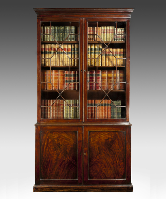 A Chippendale period mahogany cupboard base bookcase. Large Image 1