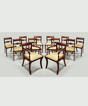A set of 12 Regency style dining chairs.