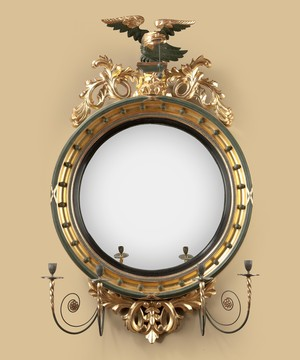 A Regency period carved giltwood convex mirror.
