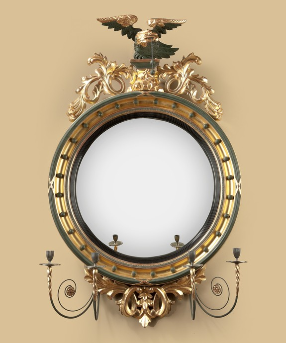 A Regency period carved giltwood convex mirror. Large Image 1