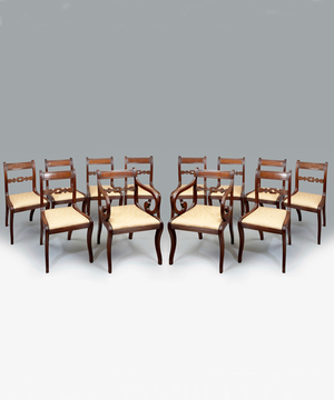 A set of 12 Regency mahogany dining chairs.