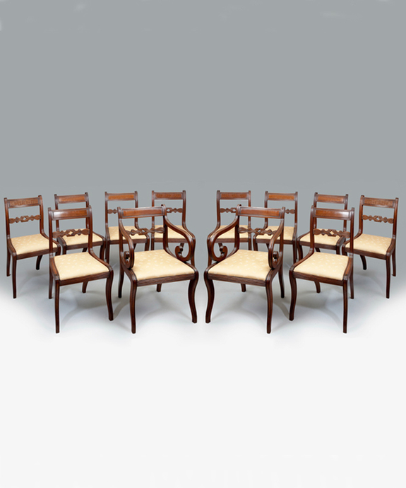 A set of 12 antique Regency mahogany dining chairs.