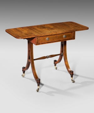 A Regency period rosewood sofa table of small proportions.