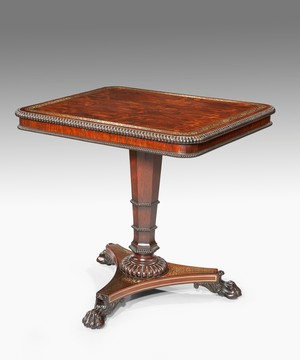 A fine Regency period rosewood veneered and brass inlaid centre table.