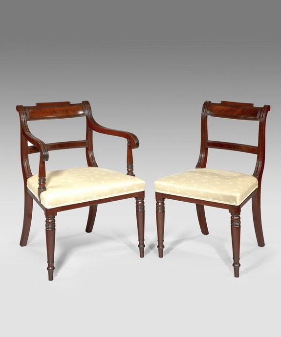A set of 14 antique Georgian mahogany dining chairs.