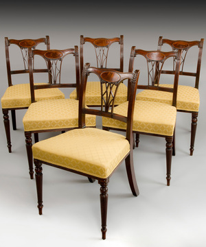 An elegant set of six Sheraton period mahogany dining chairs.