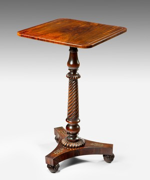 A Regency tripod table veneered in rosewood.