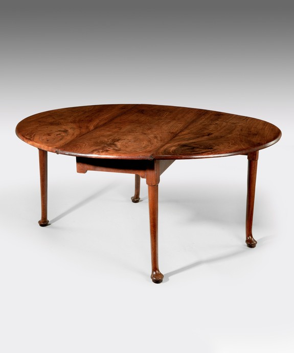 A beautifully patinated George II period mahogany pad foot dining table. Large Image 1