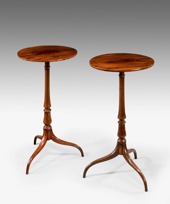 An antique pair of Sheraton rosewood tripod tables.