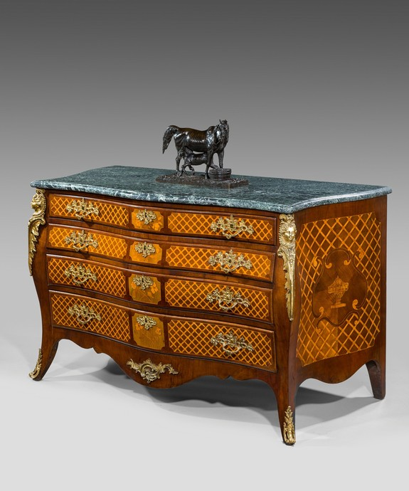 An antique Georgian bombe commode.