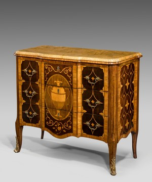 An Adam marquetry veneered commode.