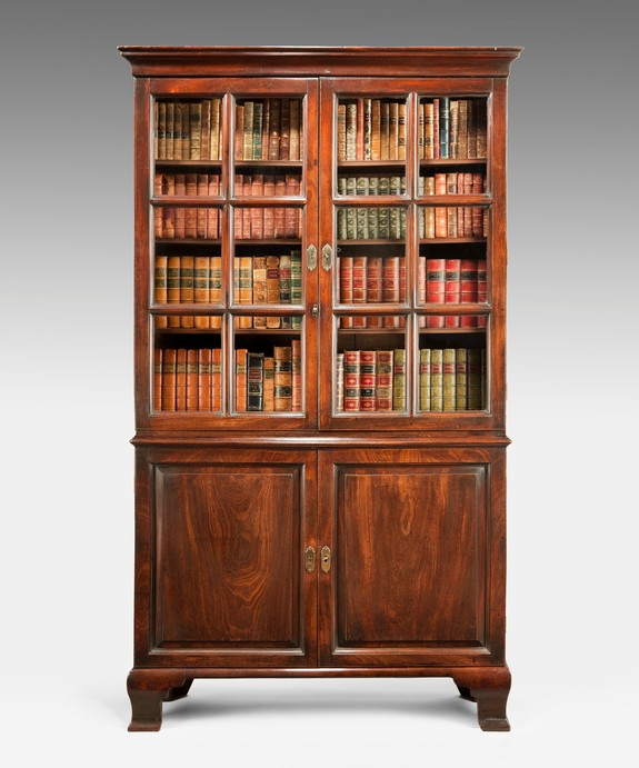 A beautifully patinated George II period mahogany cupboard base bookcase. Large Image 1