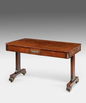 A Regency writing table in rosewood.