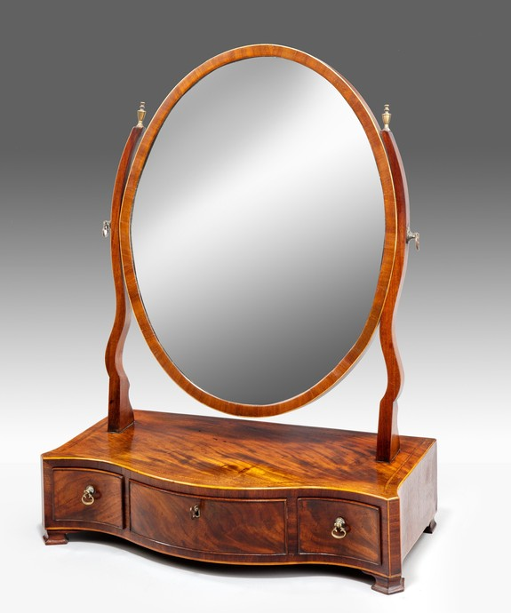An elegant Sheraton period mahogany veneered serpentine fronted dressing mirror. Large Image 1
