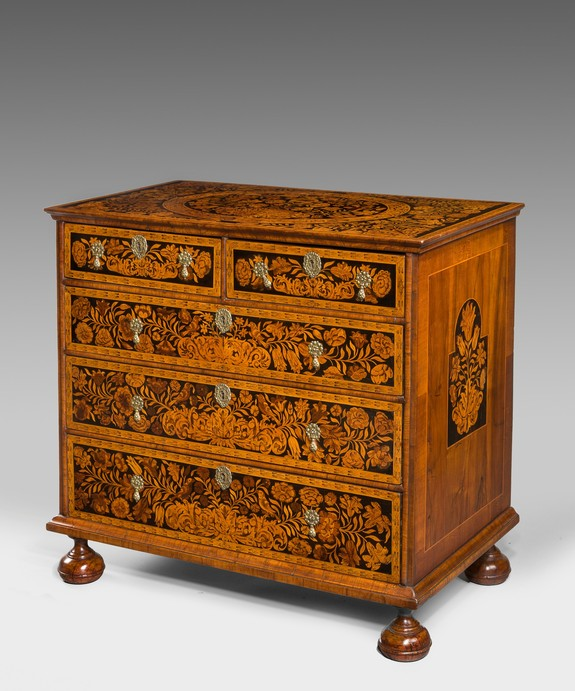 A William and Mary marquerty inlaid chest of drawers.