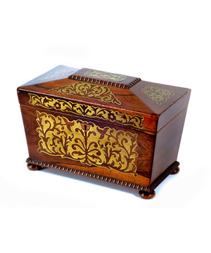 A Regency period rosewood veneered sarcophagus shaped tea caddy.