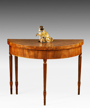 A Sheraton period mahogany demi-lune card table of unusually large proportions.