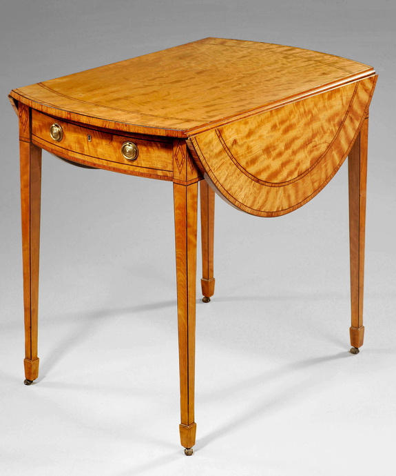 A Sheraton satinwood pembroke table.