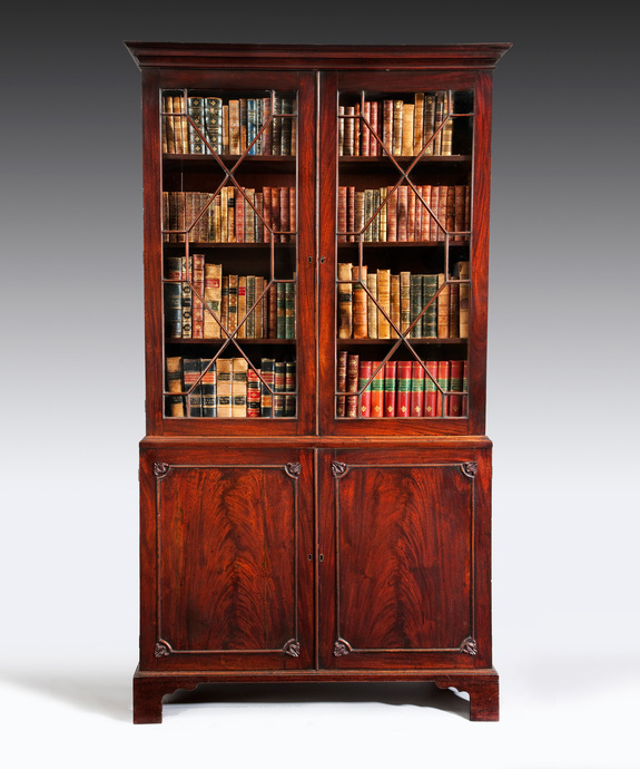 A beautifully patinated  mahogany Chippendale period 2 door bookcase. Large Image 1