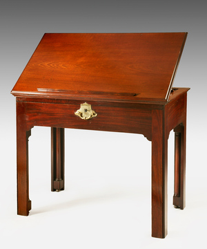 A Chippendale period mahogany lift top architect's table.