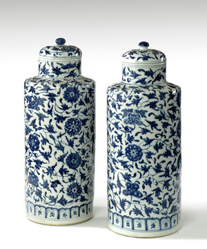 A fine pair of 19th Century blue and white Chinese vases with covers.