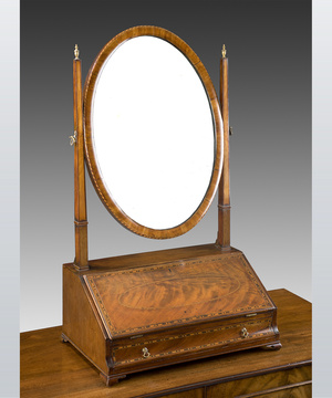 A fine Irish Sheraton revival mahogany oval toilet mirror.