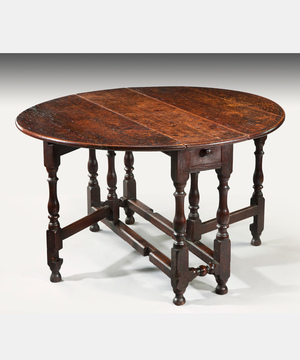 A 17th Century oak dining table.
