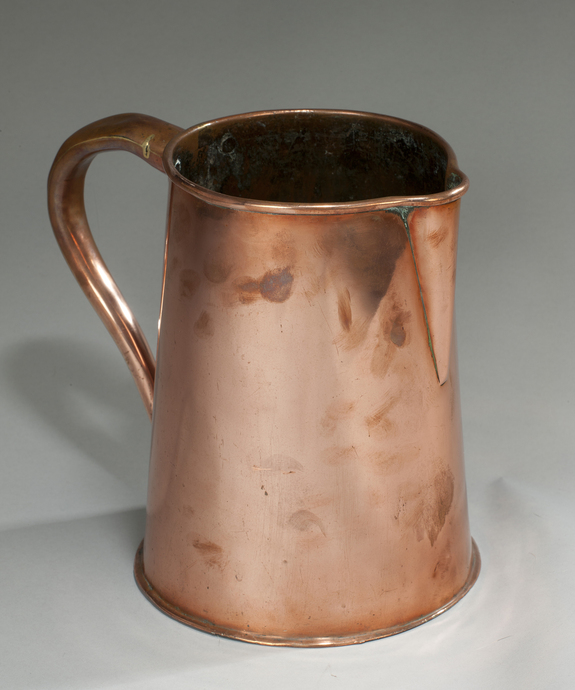 A 19th Century copper ale jug. Large Image 1