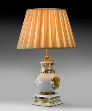 An antique French table lamp.