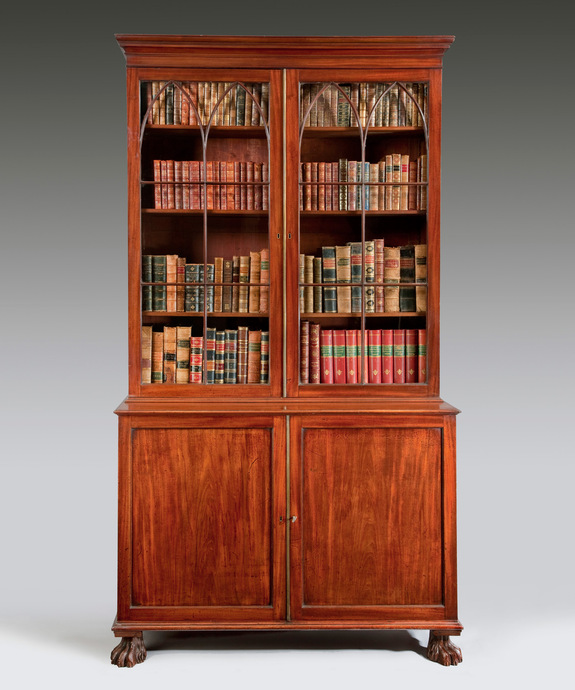 A George III period mahogany 2 door cupboard base bookcase. Large Image 1