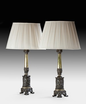 A pair of brass and spelter antique table lamps.