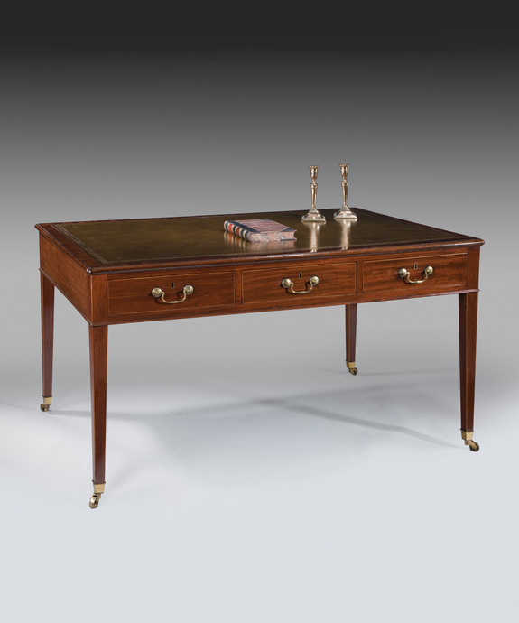 A Sheraton period mahogany six drawer writing table. Large Image 1