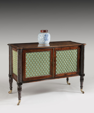 A Regency faux rosewood commode.